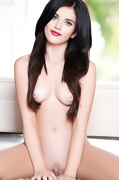 Sexy brunette Belle Sinclair