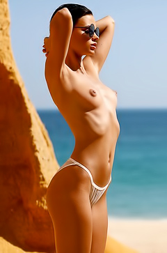 Playboy Babe Ariel Relaxing Nude On The Beach