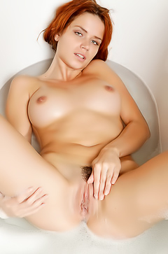 Busty redhead Kami in the bathroom gets naked