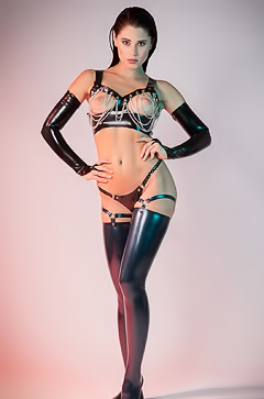 LittleCaprice tends to her needs with a dildo while in latex stockings